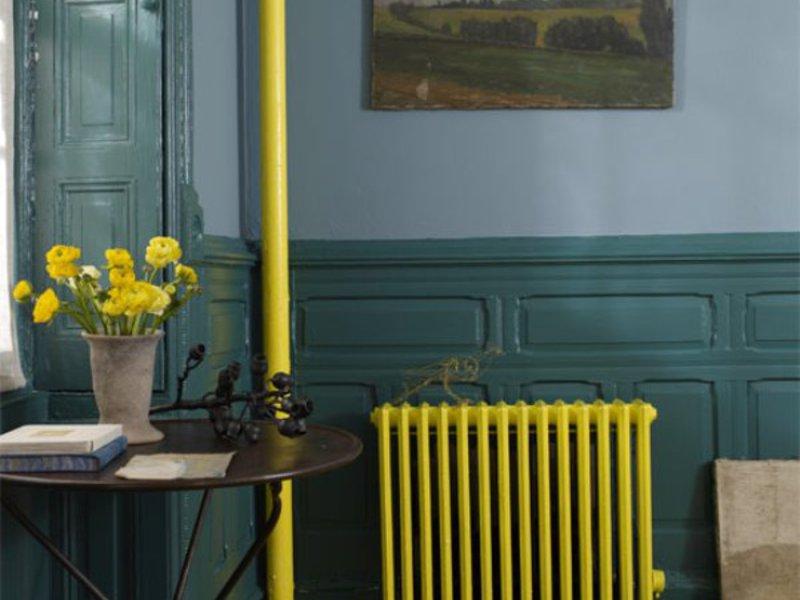 Как спрятать явно не украшающий помещение чугунный радиатор, не ухудшив обогрев?