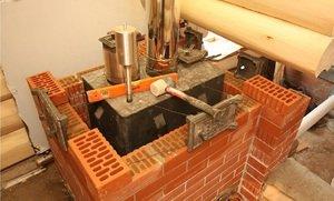 как обложить железную печь кирпичом в бане